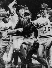 JUNE 2, 1985: Fairfield catcher Greg Price joins his teammates in celebration after the Indians won the state tournament.