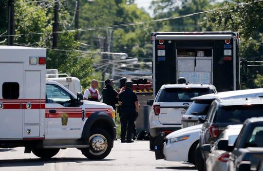 Cincinnati Police SWAT teams stage outside residence they say Jacob Julick has taken refuge inside of on the 3100 block of McHenry Avenue in the Westwood neighborhood of Cincinnati on Tuesday, June 25, 2019.