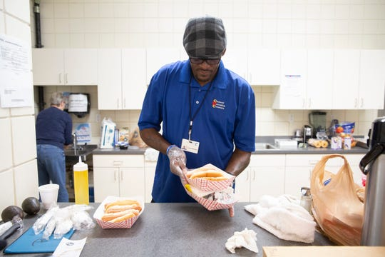 Tanaruse Witherspoon, 'Spoon' to anyone who knows him, boils up hotdogs for his day campers for snack time June 13, 2019. Though the kids are supposed to bring something to eat, some don't. Spoon said he's a frequent flyer at Kroger, purchasing the food out of his own pocket. Lunch is served by Cincinnati Public Schools at 1:30 p.m., which is late if these kids didn't eat breakfast.