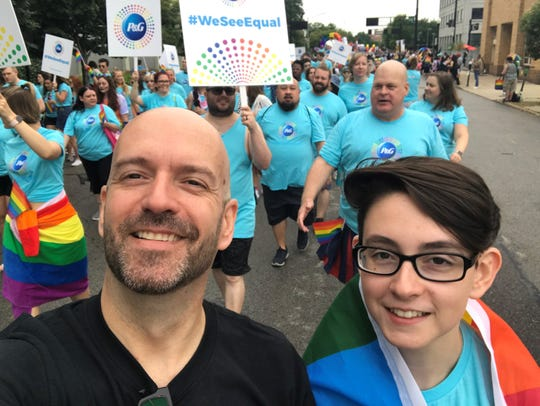 "Scott Wherle of Taylor Mill, Ky., and his daughter, Kenna, walk in the Cincinnati Pride Parade on June 22, 2019. Scott spent the day giving ""Free Dad Hugs"" to anyone who wanted one."