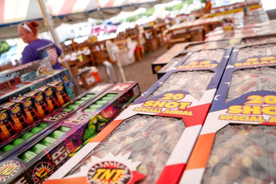 Fireworks of various size and strength are stacked up on tables at a TNT Fireworks tent in Clarksville, Tennessee, on June 25, 2019.