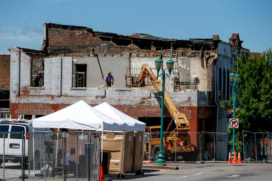 A crew of Amish craftsmen continue their work on the demolition of a historic structure downtown at the Dabbs Building in Clarksville, Tenn., on Tuesday, June 25, 2019.