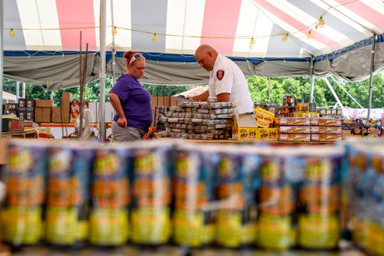 Candi Coleman speaks with Clarksville Fire Prevention Officer Michael Rios while Rios conducts an inspection at the TNT Fireworks tent at Madison Street and Memorial Drive in Clarksville, Tenn., on Tuesday, June 25, 2019.