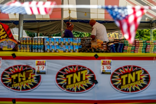 Candi Coleman, manager of the fireworks tent, speaks to Michael Rios, a Clarksville Fire Prevention Officer, when Rios visits to conduct an inspection at the TNT Fireworks tent at Madison St. and Memorial Dr. in Clarksville, Tenn., on Tuesday, June 25, 2019.
