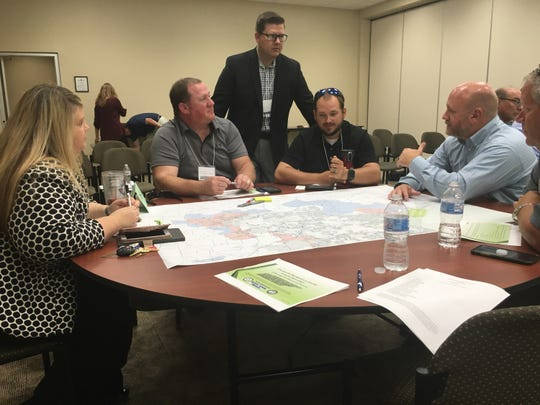 The Growth Coordinating Committee divides into subgroups to draw the boundary lines for Clarksville-Montgomery County's new Urban Growth Plan.