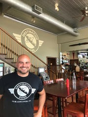 Jimmy Cronk, one of the owners and visionaries behind Destination Dogs in New Brunswick, will also be getting the restaurant's logo tattooed on himself on July 17.