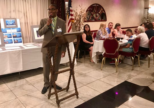 Senior Angelo McNeill, president of the fictitious company Techniche, speaking at graduation for the Linden High School Entrepreneurial Management Achievement Program on June 12 at III Amici Ristorante in Linden.