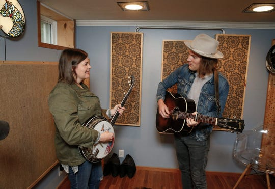 Bryan and Sarah Vanderpool, the husband and wife duo that make up the musical group The Well Pennies, play a song in the recording studio they built in the basement of their Des Moines home on Friday, June 21, 2019. The Vanderpools said the growing arts and music scene and reasonable cost of living were among the reasons they chose to relocate to Des Moines after spending years on both coasts.