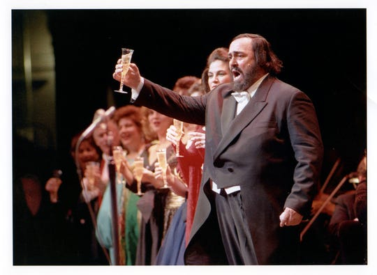 Luciano Pavarotti raises a toast at the 1996 Inaugural Gala Concert for the opening of the renovated Detroit Opera House