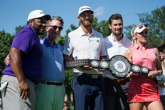 From left, Winner of the AREA 313 Celebrity Challenge Team DJ members Jerome Bettis, Dustin Johnson, Dylan Larkin and Paige Spiranac pose for a photo with Larry Burns, president and CEO of Children's Hospital of Michigan Foundation during the Rocket Mortgage Classic at Detroit Golf Club in Detroit, Tuesday, June 25, 2019.