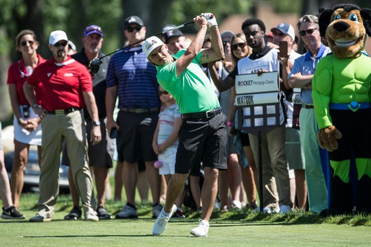 Rickie Fowler tees off for the 14th hole during the AREA 313 Celebrity Challenge at Detroit Golf Club, Tuesday.