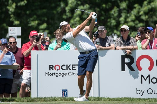 Dustin Johnson tees from the 15th hole during practice at the Rocket Mortgage Classic at Detroit Golf Club on Tuesday, June 25, 2019.