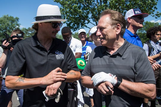 Kid Rock talks to Tom Izzo during the AREA 313 Celebrity Challenge of the Rocket Mortgage Classic at Detroit Golf Club in Detroit, Tuesday, June 25, 2019.