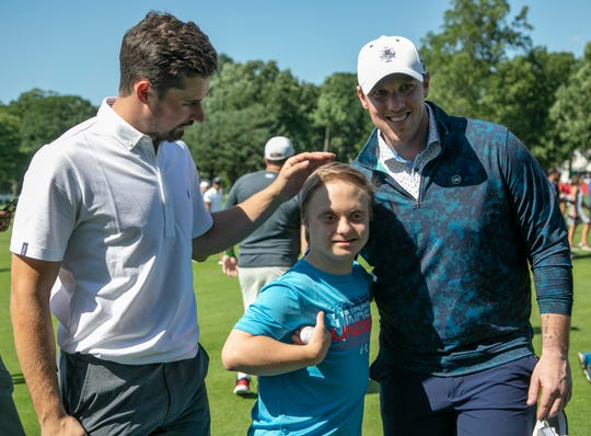 Red Wings Dylan Larkin, left, poses with adoring fan Michael Banaszewski, 14, of Grosse Pointe Woods who was handed a golf ball by Red Wings Jimmy Howard at right during The Area 313 Celebrity Challenge at the Rocket Mortgage Classic Tuesday, June 25, 2019 at the Detroit Golf Club. Banaszewski underwent chemotherapy for testicular cancer in January and decorated his Beaumont Hospital room in Redwings style.