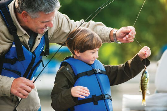 Hunting and fishing play a vital role in ensuring the long-term survival of Michigan's native plant and animal populations, notably through funding wildlife management and conservation throughout the state.