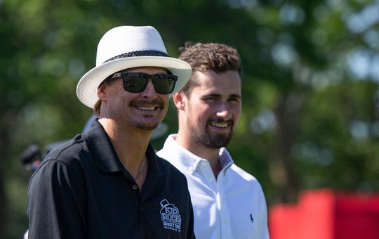 Kid Rock looks on with Red Wings Dylan Larkin in the background during The Area 313 Celebrity Challenge at the Rocket Mortgage Classic Tuesday, June 25, 2019 at the Detroit Golf Club.
