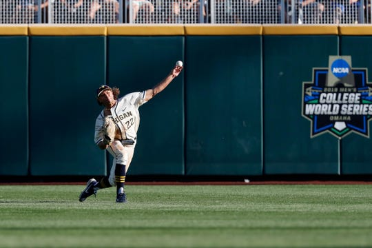 Michigan right fielder Jordan Brewer throws the ball against Vanderbilt during the second inning in Game 1 of the NCAA College World Series baseball finals in Omaha, Neb., Monday, June 24, 2019.