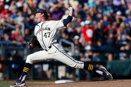 Michigan Wolverines starting pitcher Tommy Henry during the first inning against Vanderbilt Commodores in Game 1 of the championship series of the 2019 College World Series at TD Ameritrade Park, June 24, 2019, in Omaha, Neb.