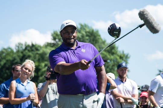 Team DJ Jerome Bettis aims before tee off at the 14th hole during the AREA 313 Celebrity Challenge of the Rocket Mortgage Classic at Detroit Golf Club in Detroit, Tuesday, June 25, 2019.