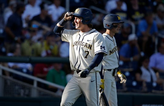 Michigan's Jesse Franklin (7) celebrates after scoring against Vanderbilt during the first inning in Game 1 of the NCAA College World Series baseball finals in Omaha, Neb., Monday, June 24, 2019.