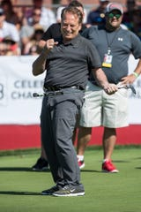 Tom Izzo celebrates putting the ball on the 16th hole during the AREA 313 Celebrity Challenge of the Rocket Mortgage Classic at Detroit Golf Club in Detroit, Tuesday, June 25, 2019.