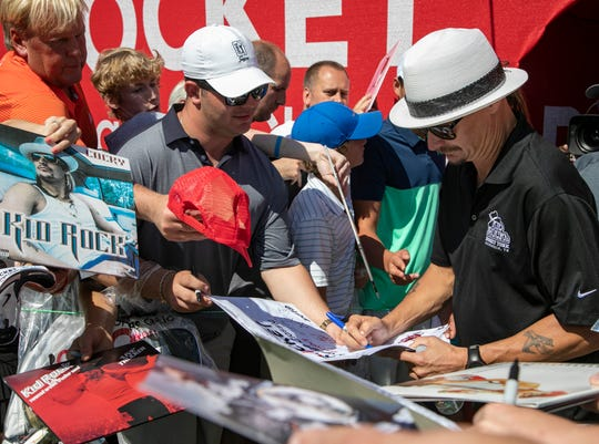 Kid Rock signs autographs between holes during The Area 313 Celebrity Challenge at the Rocket Mortgage Classic Tuesday, June 25, 2019 at the Detroit Golf Club.