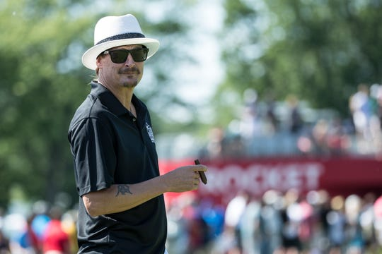 Kid Rock lights up a cigar before tees off at the 15th hole during the AREA 313 Celebrity Challenge of the Rocket Mortgage Classic at Detroit Golf Club in Detroit, Tuesday, June 25, 2019.