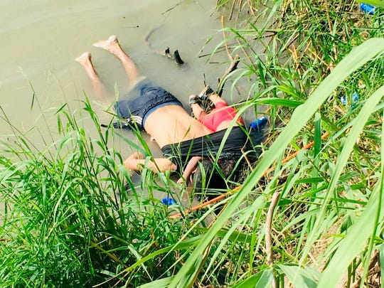 The bodies of Salvadoran migrant Oscar Alberto Martinez Ramirez and his nearly 2-year-old daughter Valeria lie on the bank of the Rio Grande in Matamoros, Mexico, Monday, June 24, 2019, after they drowned trying to cross the river to Brownsville, Texas.
