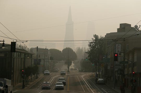 The Transamerica Pyramid is obscured by smoke and haze from wildfires in San Francisco. Tens of millions of people in the Western U.S. face a growing health risk due to wildfires as more intense and frequent blazes churn out greater volumes of lung-damaging smoke.