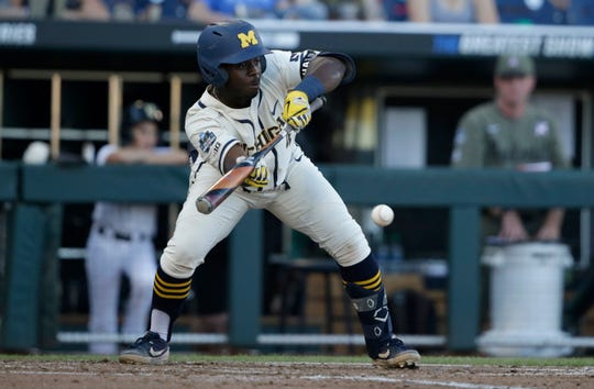 Michigan second baseman Ako Thomas bunts against Vanderbilt during the fourth inning in Game 1 of the College World Series.