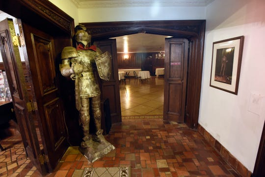 The suit of armor greets people who walk into the ballroom at the home of Judith Doss in the Palmer Woods subdivision near the Detroit Golf Club.