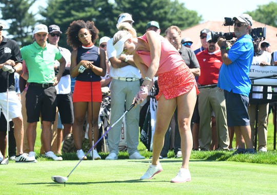 Paige Spiranac is run off the 15th tee during the Area 313 Celebrity Challenge at the Detroit Golf Club
