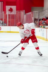 Defenseman Moritz Seider skates with the puck during the Red Wings development camp Tuesday at Little Caesars Arena in Detroit.