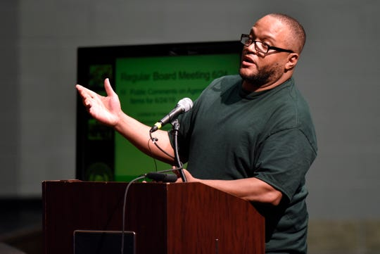 Harvey Savage addresses the Grosse Pointe Public Schools' Board of Education during public comments Monday.