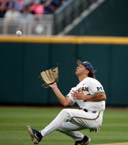 Michigan right fielder Jordan Brewer grabs a fly out by Vanderbilt's Philip Clarke in the second inning.