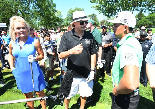 Golfer Blair O'Neal, Kid Rock and golfer Rickie Fowler chat before the celebrity challenge.