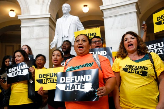 Protesters gather to demand the defunding of government agencies for border protection and customs enforcement, Tuesday, June 25, 2019, on Capitol Hill in Washington.