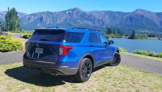 The 2020 Ford Explorer ST is distinguished by its quad tailpipes in the rear.