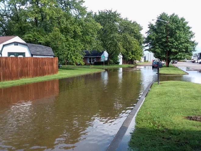 Iroquois Drive on the East Side is among the streets that have flooded excessively since the construction of a credit union's headquarters and other projects on nearby Theater Drive.