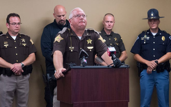 Perry County Sheriff Alan Malone, center, becomes emotional while providing details on the accidental death of eleven-year-old Isabelle Meyer while attending the Girl Scouts of Southwestern Indiana's Camp Koch at the Perry County Sheriffs Department in Tell City, Ind. Tuesday, June 25, 2019.