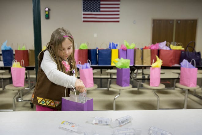 Isabelle Meyer of Jasper, Ind. adds hand sanitizer to gift bags for chemotherapy patients during a meeting of Girl Scout Troop 670 in this file photo from 2016. Isabelle, now 11, was killed Monday, June 24, 2019, when a tree fell on her and three others during a Girl Scout camp at Camp Koch near Cannelton, Ind.