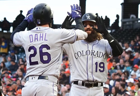 Colorado Rockies outfielders David Dahl and Charlie Blackmon exchange high-fives after Dahl's two-run homer Monday night in a 2-0 win at San Francisco. The Rockies wrap up a nine-game West Coast road swing with a 1:45 p.m. game Wednesday in San Francisco.