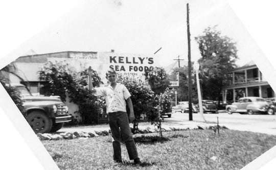 Patrick Kelly in front of the family seafood market in 1948.