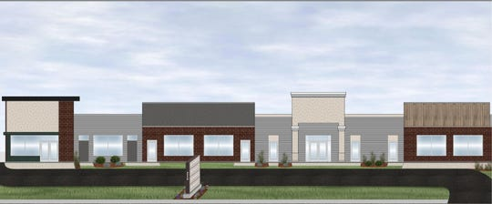 A rendering of the new, multi-tenant building proposed for the Ethan Allen Interiors site, 2350 S. Oneida St.