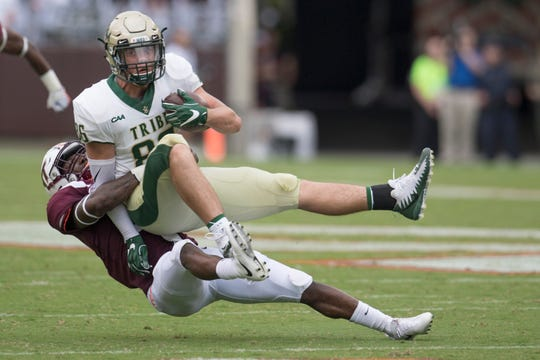 William & Mary tight end Nick Muse (86), who recently transferred to South Carolina, is brought down by Virginia Tech's Chamarri Conner (22) in this 2018 file photo.