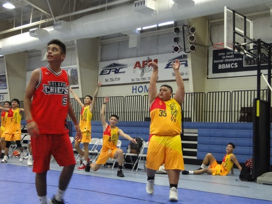 Southside's Brennan Chaco chucking a three as his teammates look in a recent game at the 2019 Summer Sizzle Hoops Fest in Sinajana.