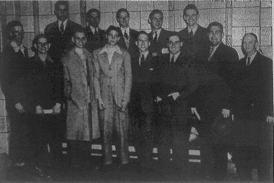 Indiana University's basketball team is pictured just before they boarded the train for Kansas City March 28, 1940 where the Hoosiers competed against Kansas in the final game of the NCAA tourney.  Front row (left to right) Andy Zimmer, Paul (Curly) Armstrong, Capt. Marvin Huffman, Bill Menke, Chet Francis, Bob Dra, Coach Branch McCracken and Jesse (Doc) Ferguson, trainier, Second row: Bob Menke, James Gridley, Jay McCreary, Ralph Dorsey and Herman Schaefer.