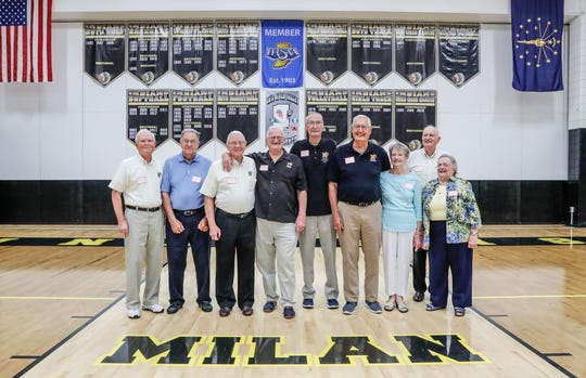 """Members of the 1954 Milan Indians state championship team, cheerleaders, and more, pose for a photo during the 65th anniversary reunion of the team, held at Milan High School, in Milan Ind. on Saturday, June 22, 2019. The film """"Hoosiers"""" was based on the teams 1954 state championship win dubbed the """"Milan Miracle."""" Milan 1954 championship team members Etc., left to right: Roger Schroder, Manager Oliver Jones, Ray Craft, Bobby Plump, Glen Butte, Rollin Cutter, Cheerleader Pat Marshall, Gene White, and Mary Lou Wood, the widow of Coach Marvin Wood."""