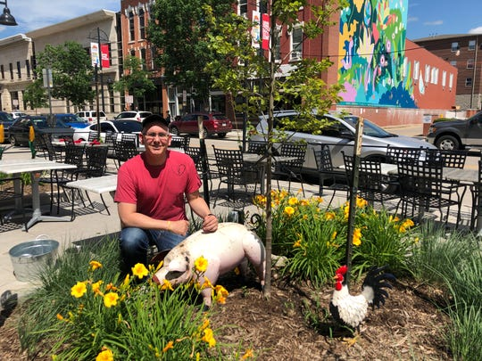 Iowa Chop House owner George Etre poses with Choppy the Pig after he was returned Tuesday, June 25, 2019. Video surveillance showed someone taking the pig early Saturday morning.