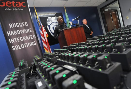 Jackson Police Public Information Officer Sam Brown explains the training timeline and use of the new JPD body cams during a news conference at JPD headquarters Tuesday, June 25, 2019. Training begins later this week with patrol officers on the streets outfitted with Getac Video Solutions body camera. With Brown is Scott Worley with Getac out of Minneapolis, Minn.